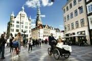 Newlyweds driving in a cargobike in the streets of Copenhagen.