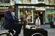 Wedding couple in a cargo bike in the streets of Copenhagen.