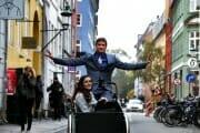 Wedding couple in a cargo bike in the streets of Copenhagen, Denmark.