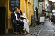 Wedding couple sitting in the streets of Copenhagen.